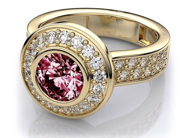 Bezel set modern halo pink tourmaline ring in 14k yellow gold 128 carat.