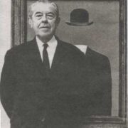 Rene Magritte in front of his painting Pilgrim. 1966