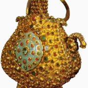 A small pitcher with oval medallions. Gold, precious stones