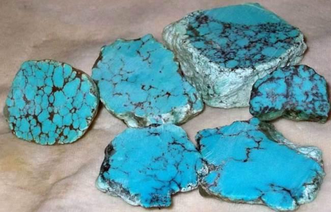 Light blue turquoise in black coal shale. Kingman Turquoise mine, Arizona, United States