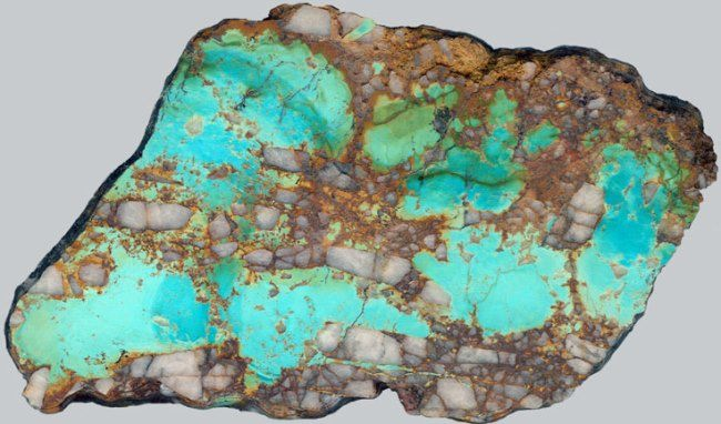 Multicolor turquoise with limonite in quartz. Uzbekistan. Photo collection by V. Sletov