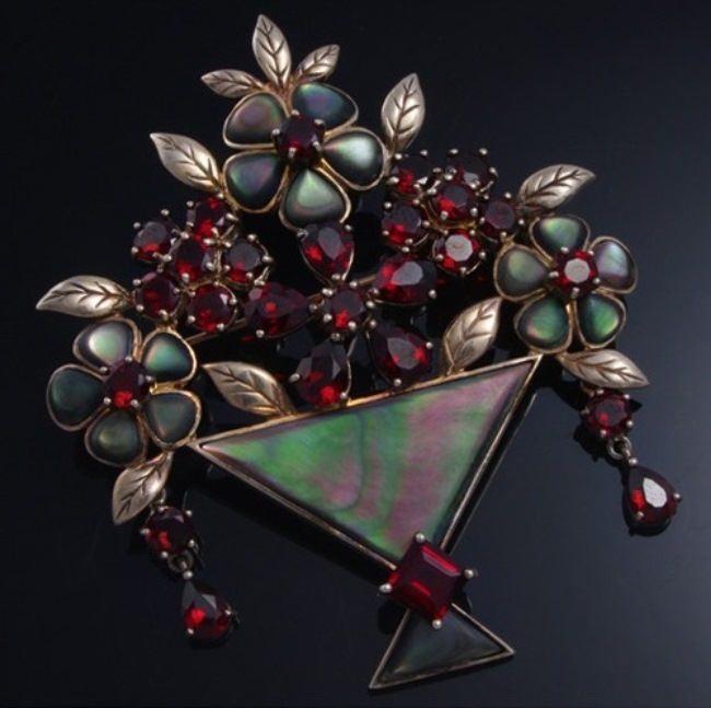 Brooch of the Victorian era. Opals, garnets, silver