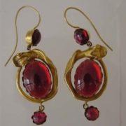 Earrings with garnets. Victorian era