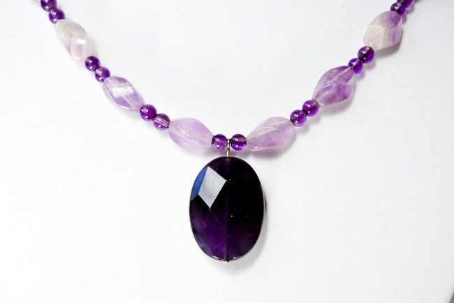 Amethyst necklace consisting of lavender amethyst beads and a deep purple amethyst pendant