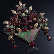 Brooch of the Victorian era. Opals, garnets, silver