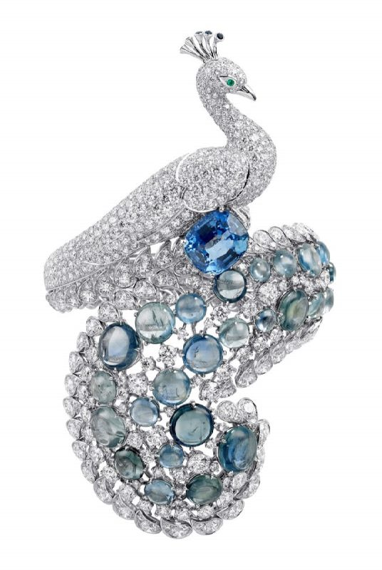 Cartier. Brooch with diamonds, sapphires, emerald