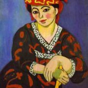 Madame Matisse wearing a striped red dress. 1907